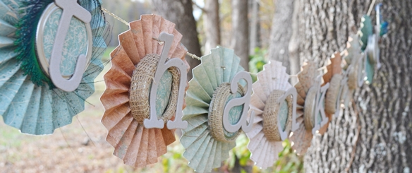 Paper Rosette Garland Tutorial by Peckled via One Stylish Party